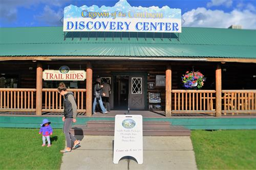 The Crown of the Continent Discovery Center is a park and ride shuttle top for Glacier National Park guests. Located just 1.5 miles from the park entrance