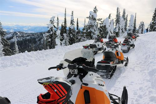 Reaching the summit of Big Mountain at Whitefish Mountain Resort is easy with our new snowmobiles!