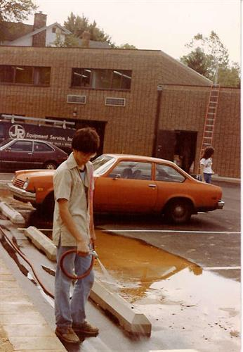 A young Al Matarazzo washing the parking lot of the Matarazzo family-owned Dunkin Donuts