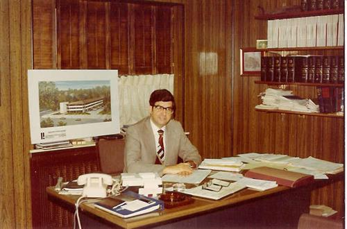 Fred Matarazzo sitting at his desk ... gotta love that 1960's wood paneling