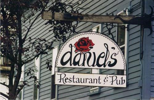 Daniel's Sign & logo