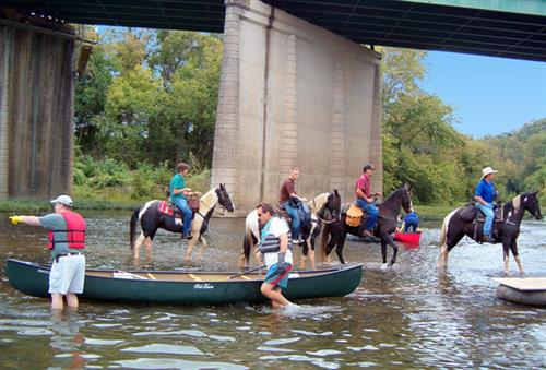 Gallery Image Horses_and_canoes_in_river(1).jpg