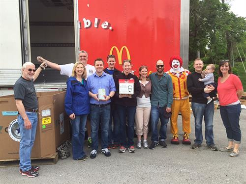 The team at Ronald McDonald's Pop Tab Pandemonium donating keys and pop tabs