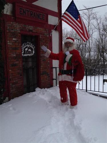 """Even we Coasties get the occassional snowfall!  All the better for Santa (owner, Ray Shackelford) to stop in and say """"Hi""""!"""