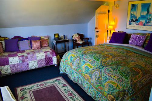 The Hideaway's king-size bed with featherbed top, extra lounging bed, electric fireplace, skylit shower and glass block accents is the innkeeper's pick!