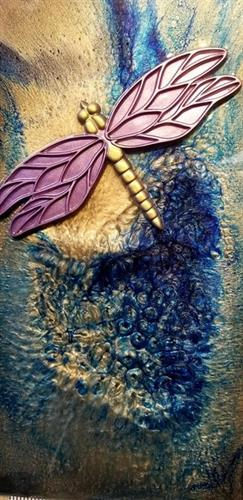 3-D dragonfly created from volcanic ash & sand on canvas