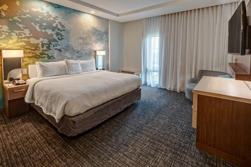 The King Suite's separate sleeping area allows for rest and relaxation while you flip on the flat-screen TV and enjoy Marriott's luxury bedding with plush mattresses, crisp linens, and fluffy pillows.