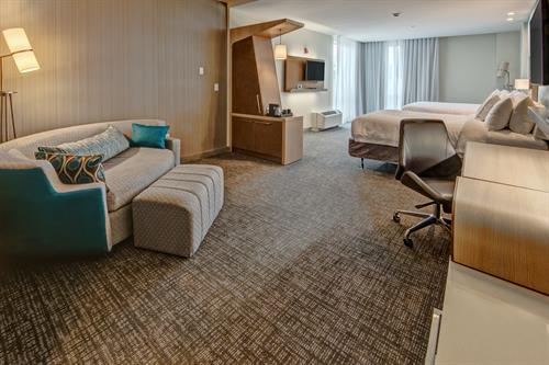 Enjoy the space in our extended living room space in our queen suite.