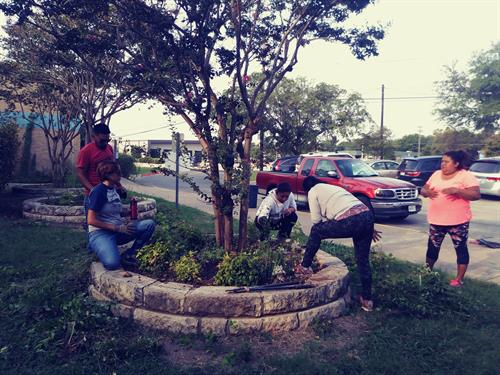 GAVA resident leaders conducting a neighborhood beautification day.