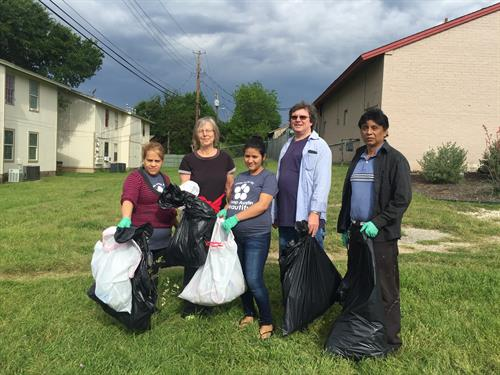 GAVA resident leaders from La Fuerza de Westage team participating in a neighborhood beautification day.