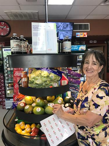 GAVA resident leader Sue proudly showing off the new open-air refrigerator at Bread Basket on Westgate and Jones Rd to hold fresh grab-and-go foods!