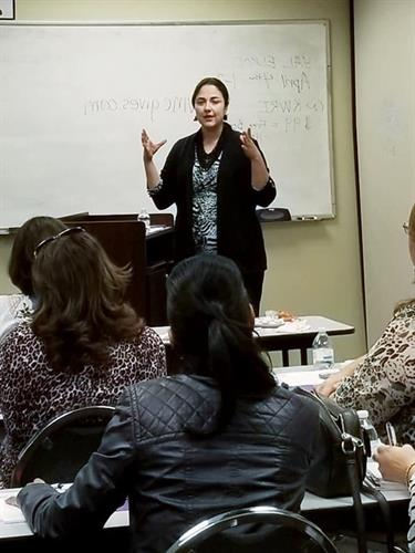 Providing a presentation on Business Development at the Women's Center of Central Texas