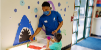 Gallery Image YMCA_child_care_with_masks_2.jpg_thumb.png