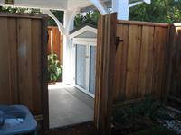 Private, landscaped back yards, gate and storage room