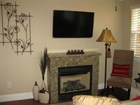 3 Flat screen TVs in each home + Fireplaces
