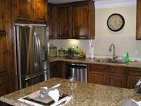 Granite counters, all the extras -walk in and cook
