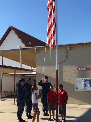 China Lake sailors teach students how to raise the flag