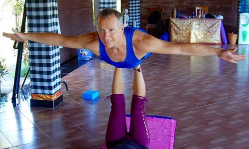 Chris flying in Bali.