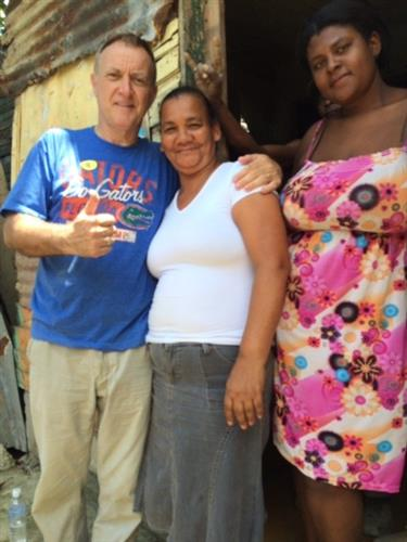 Social impact trip Domincan Republic, Homeowners after we cemented a floor in the house