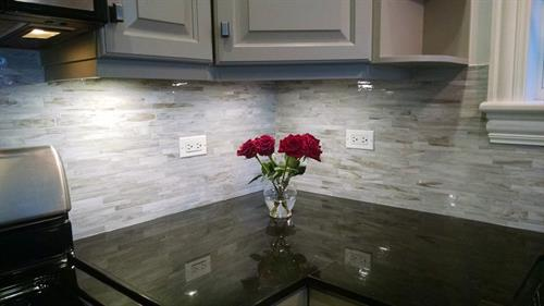 Installed a back splash in kitchen, helped client pick a tile that made her tiny kitchen look bigger.