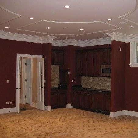 Painted both ceiling, crown molding and walls in this lower level TV room