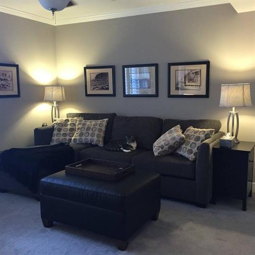 Repainted this room a soft blueish gray making this living room more relaxing.