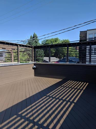 Stained deck, then added containers and raised bed for this Condominium in the city
