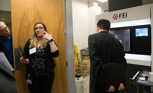 Dr. Tera Lavoie leads a tour group in the Transmission Electron Microscope lab