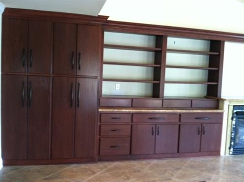 Custom Cabinet Finish and Wood Graining in Cherry Maple to match new kithen cabinets. Original wall unit wood was light pine.