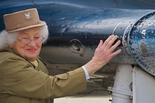 102-year-old veteran admiring her work from 70 years ago.