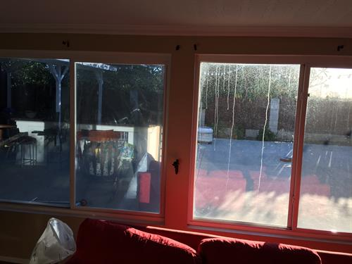 Window film installation in Yorba Linda. The heat reduced by this particular window film was 73%.