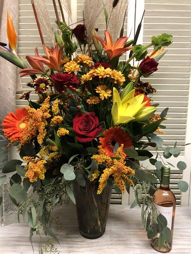 Upscale sympathy designs.  Seasonal blooms & colors. Lovely & lush vase.