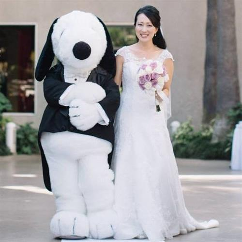 Snoopy walked me down the aisle on my big day. Literally! I'm thinking of creating a travel vlog from my archived footage. Stay tuned at YouTube.com/KimbopTV!