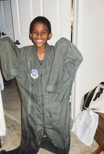 My son trying on Uncles flight suit
