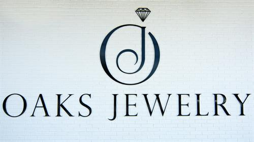 Gallery Image Oaks-Jewelry-Logo-Sign-Brick.jpg