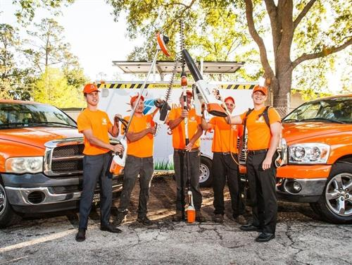 The Sun Power Lawn Care Team showing off our lawn service equipment in Gainesville, FL.