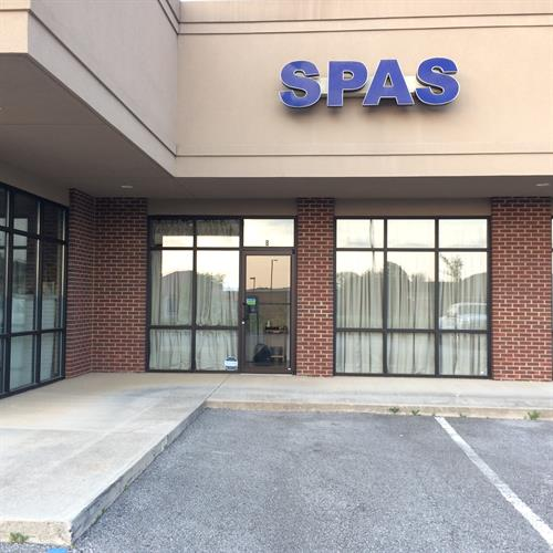 Our front door is located under the SPAS sign