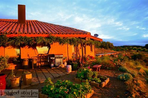 Adobe and garden at sunrise