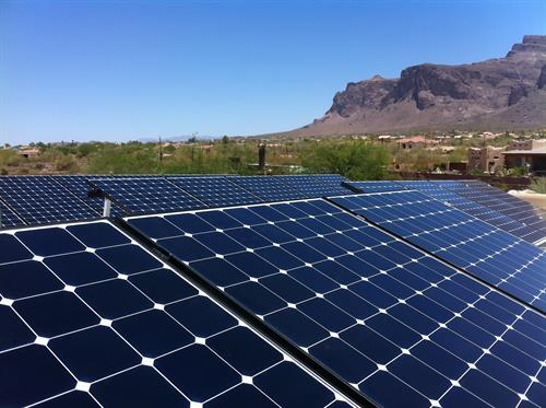 Solar panels with scenic Phoenix in the background
