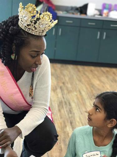 Breaking Barriers through Mentorship a special moment with the Queen and her mentee
