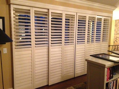 Sliding Shutters are a beautiful change from the usual vertical blinds.