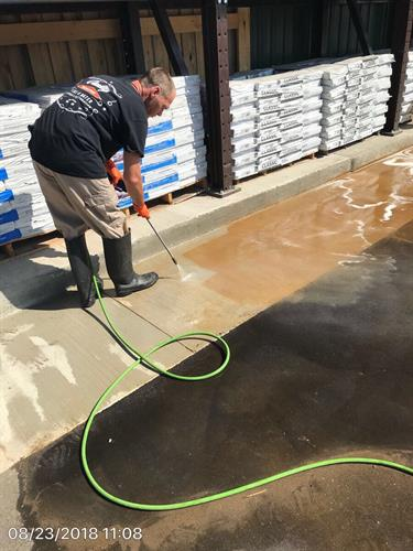 One of our technicians performing rust removal on a Commercial building.