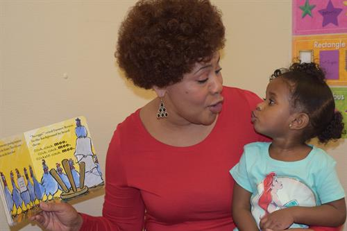 Toddler teacher, Ms. Jackie, reading a story.