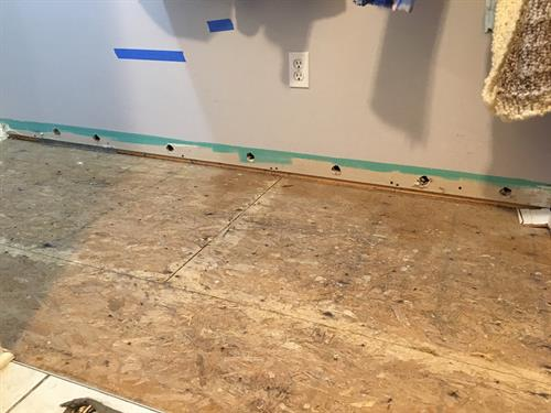 Instead of removing drywall we often can use air holes to dry it instead, and cover them later with the baseboard.