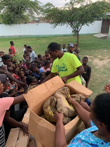 Food being distributed to orphans in Haiti