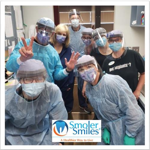 Team Smoler all geared up in PPE ready to help you!