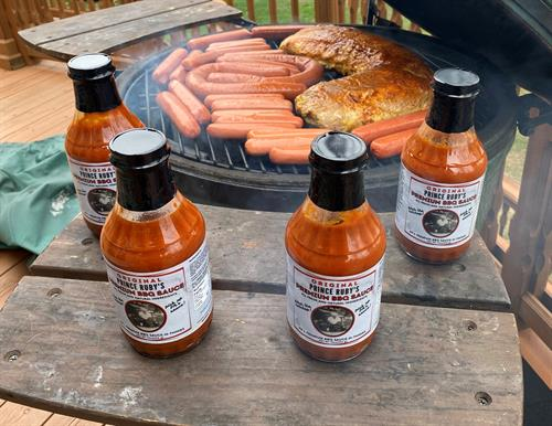 """Pork Loin and Beef Steak Hot Dogs and Sausages being prepared with Prince Ruby's Premium BBQ Sauce waiting in the """"wings!!"""""""