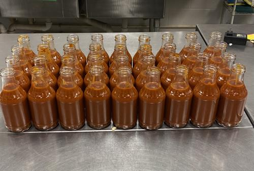 Hot of the Press!!  Ready for capping and labeling process!