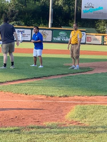 Dr Albaran throws the first pitch at JJ Field August 27, 2021