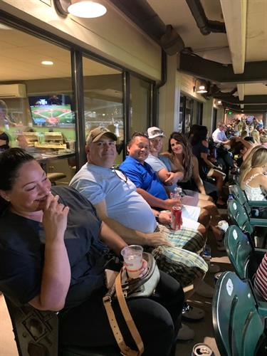 Doctors and Staff at JJ Field watching a game 2021